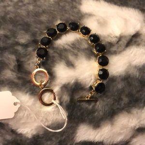 Fashionable gold tone and black bracelet. 🖤💛